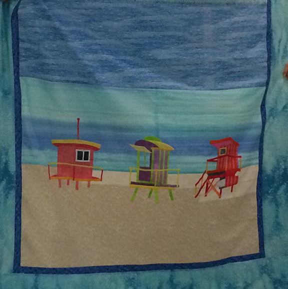 Seawatch:  This quilt depicts the iconic lifeguard stands on Miami Beach, and reminds us of what being near the water brings.